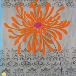 orange flower on damask patterned background